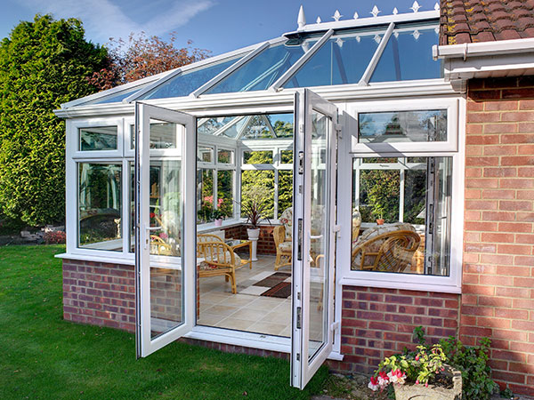 Conservatory with side entrance installed by Isis Windows in Oxfordshire