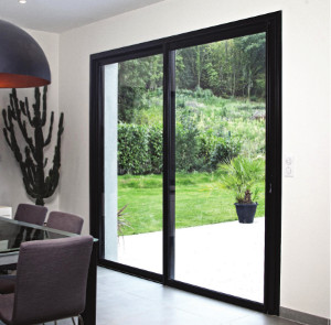 aluminium sliding doors leading onto garden from modern dining room