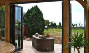 Patio Door Trends for 2020 - Bi-fold Doors overlooking countryside garden