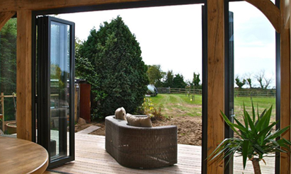 Patio Door Trends for 2020 - Bi-fold Doors overlooking countryside garden